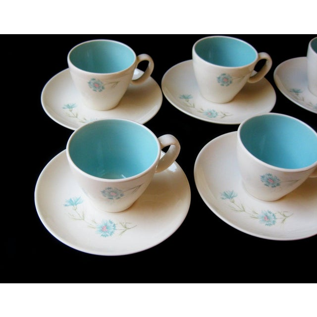 Mid-century tea set with a robin's egg blue bachelor button flower design on off white Sold as a set of 8 tea cups and 8...