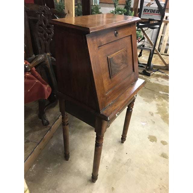 Eastlake ladies desk from the 1880s. Made of sturdy oak and opens up to reveal a writing surface and storage for...
