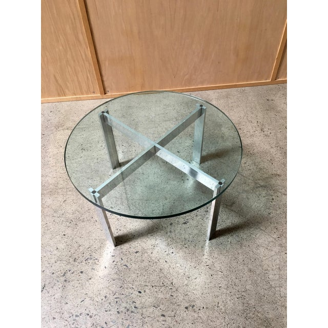 Aluminium X-base with glass top. Wear consistent with age and use