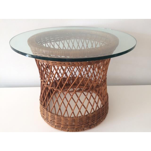 Vintage McGuire rattan round side table with glass top. Great for a Hamptons beach house or a Palm Beach cottage.