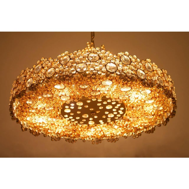 Fantastic chandelier of gilded brass and crystal glass by Palwa, Germany, 1960s. Measures: 67cm (26 in.) diameter, total...