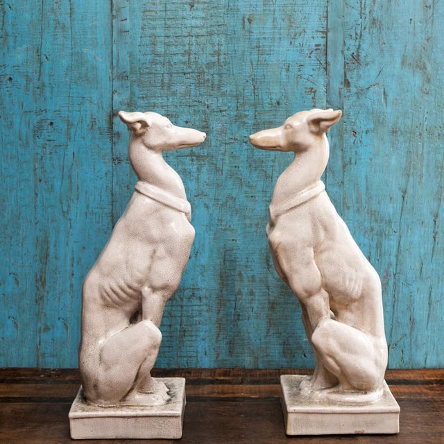 This lovely pair of vintage ceramic greyhound statutes make the perfect addition to home or business decor- Standing over...