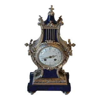 Late 19th Century Louis XVI Style Silvered Metal and Lapis Lazuli Mantle Clock by A. Chapus, La Gerbe D'Or. For Sale