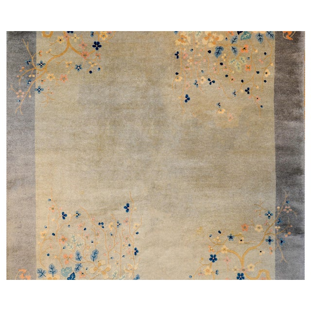 A serene and sophisticated early 20th century Chinese Art Deco rug with a tone on tone grey ground and border, and...