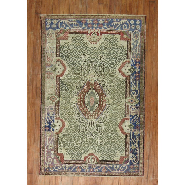 An early 20th century antique turkish ghiordes rug in earthy greens and blues. Since the beginning of their production in...