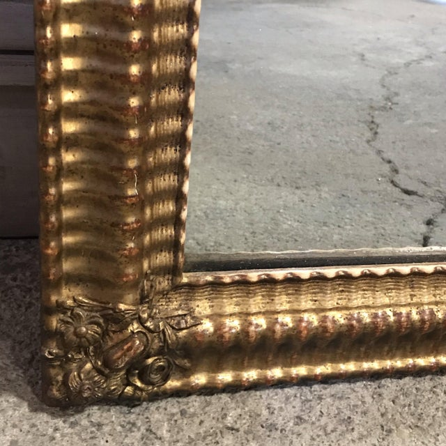 Antique French water gilded mirror with gorgeous original frame. Great aged patina, in some areas where the gold has worn...