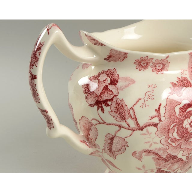 Johnson Brothers English Chippendale 32 Oz Pitcher features a red/pink transfer ware floral design. This lovely little...