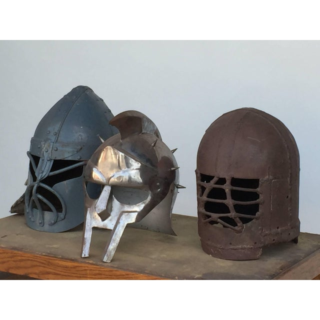 Decorative collection of three movie prop masks. Measuring largest mask is 13 in. tall x 12 in. diameter.