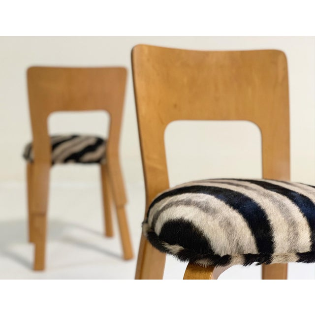 Designed by Alvar Aalto, the high-back dining chair has a solid birch core with birch laminate and face material. Solid...