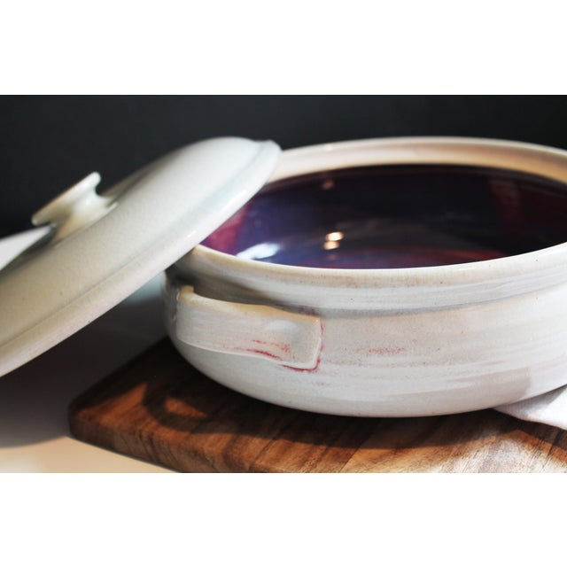 Beauty is within this otherwise unassuming casserole dish. A surprise hit of a mysterious eggplant shade inside will...