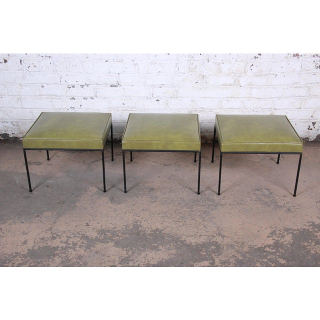 A rare set of three matching mid-century modern stools or ottomans designed by Paul McCobb. The stools feature nice black...