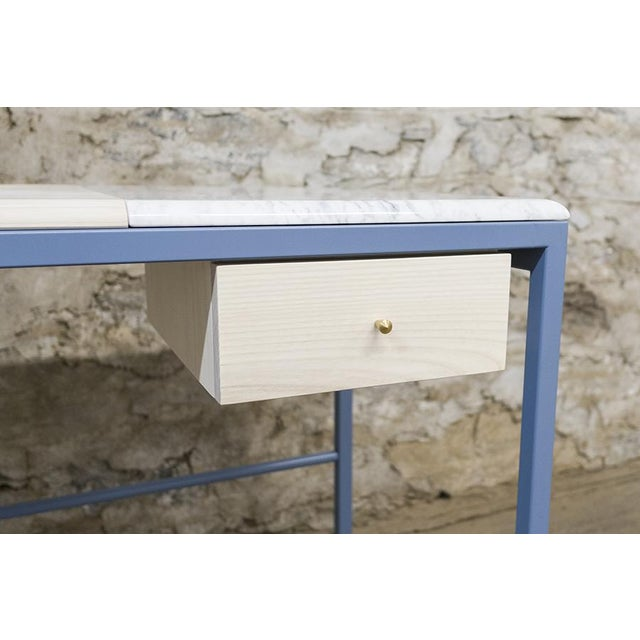 Bleached ash veneer with solid ash, marble, inset cork and mirror Fabric lined poplar drawer with turned brass drawer pull...