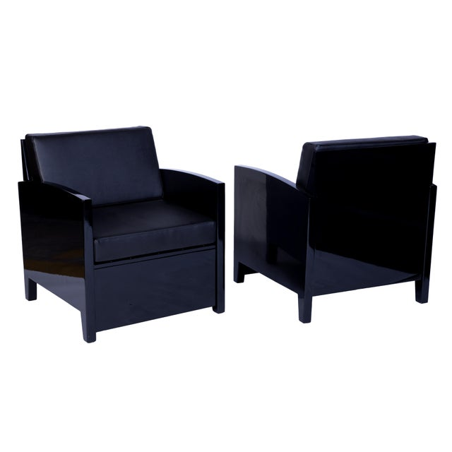 This exceptional pair of Art Deco armchairs feature a beautiful high gloss black lacquer finish with a plush slate leather...