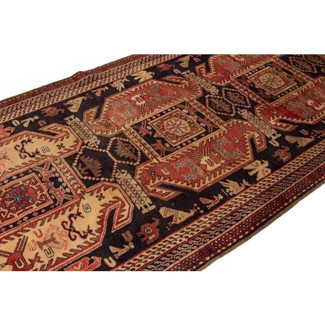 Vintage hand-knotted north west Persian rug with a traditional geometric design. This piece has great detailing and...