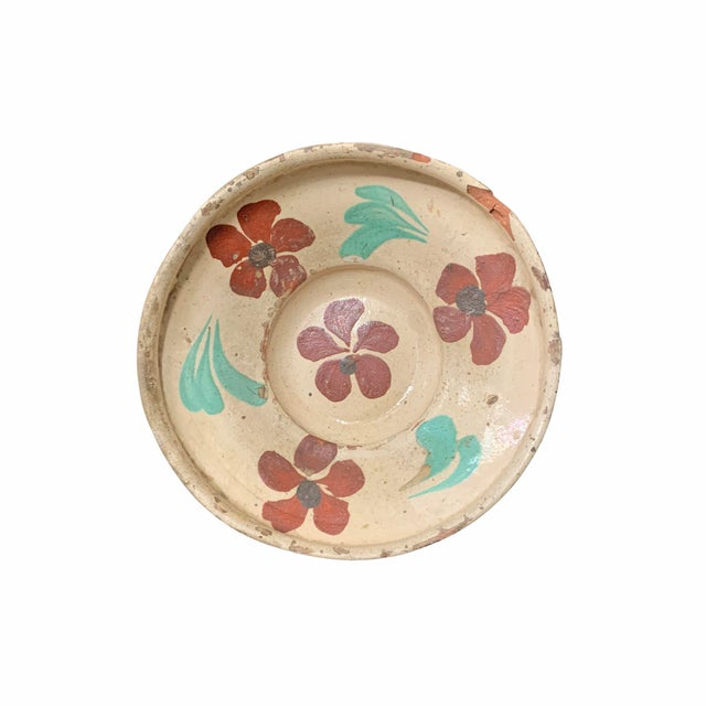A fantastic and rare set of twelve 19th century Hungarian folk ceramic bowls, each slip glaze painted with unique floral...