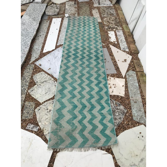 This is made of really soft handspun wool. The rug technique is called a Tulu (meaning long haired). The zigzag offers a...