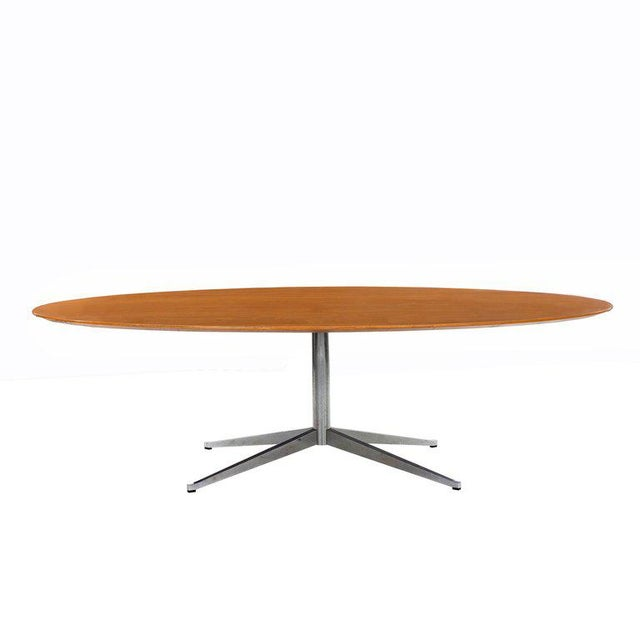 Florence Knoll for Knoll International oval dining table or executive desk. Oak top with beveled edge, X base, polished...