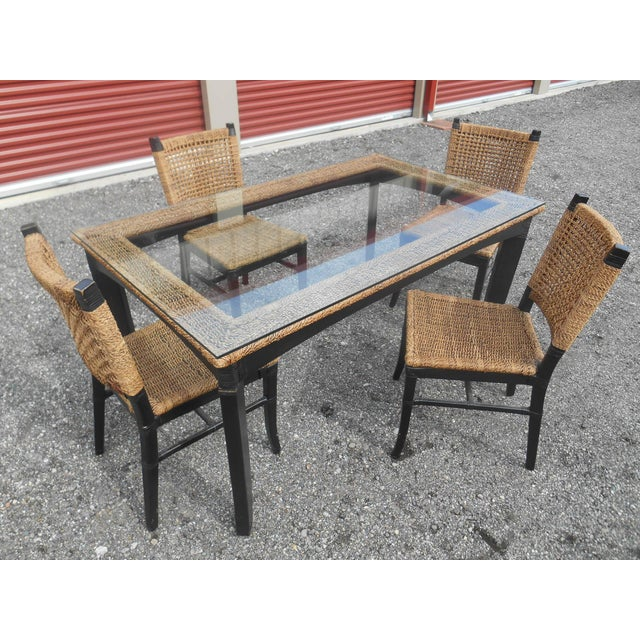 I have a very nice vintage Tommy Bahama Woven Cord Dining Set, Table with 4 Chairs. This set is in very good vintage...