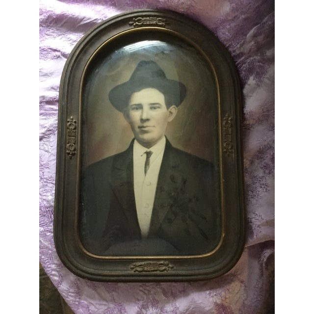 This ornately framed blue eyed gentleman has been captured in a artistic photo. He appears to be a handsome, likened to a...