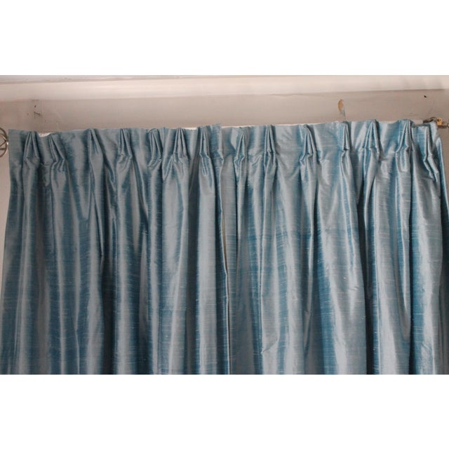 The most beautiful chambray ( blue) 100 % silk drapes, drapery pins can be moved to make it French pleats, pinch pleats...