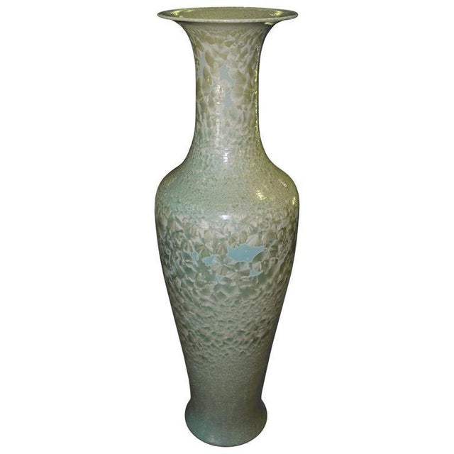 Set of three tall Celadon porcelain floor vases made in Hong Kong. These beautiful vases have different shades of light...
