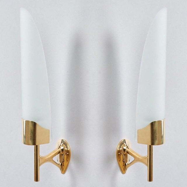 Max Ingrand (1908-1969) A beautiful pair of long, curved frosted glass sconces on sculptural projecting mounts with...