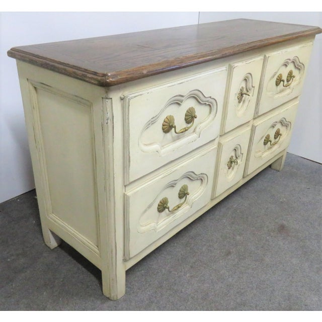 Roundtree French Style Cream painted Server, oak top, cream painted base with interior shelving.