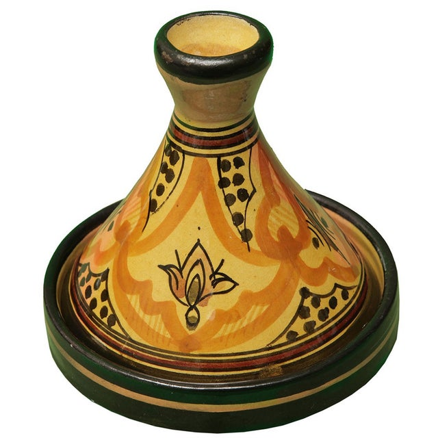 Offered is a handcrafted decorative glazed ceramic lidded bowl with hand-painted Berber symbols. It is sure to make a...