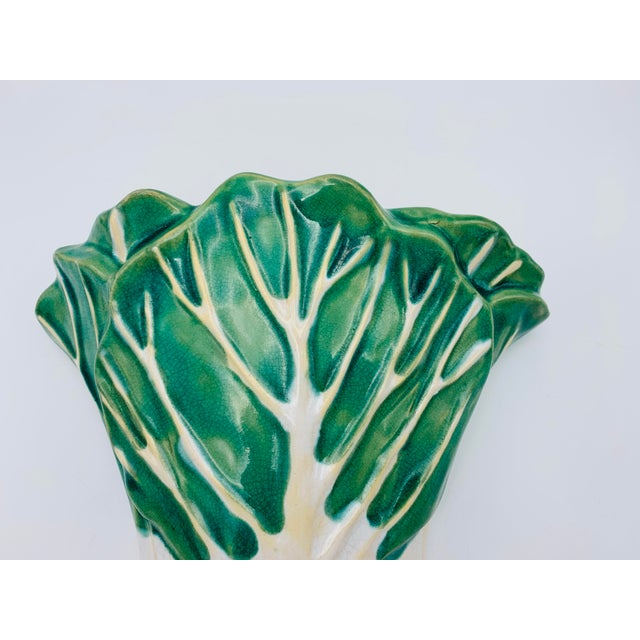 Listed is a beautiful, 1960's green and white ceramic, Chinoiserie bok-choy wall pocket. The piece has a single mounting...