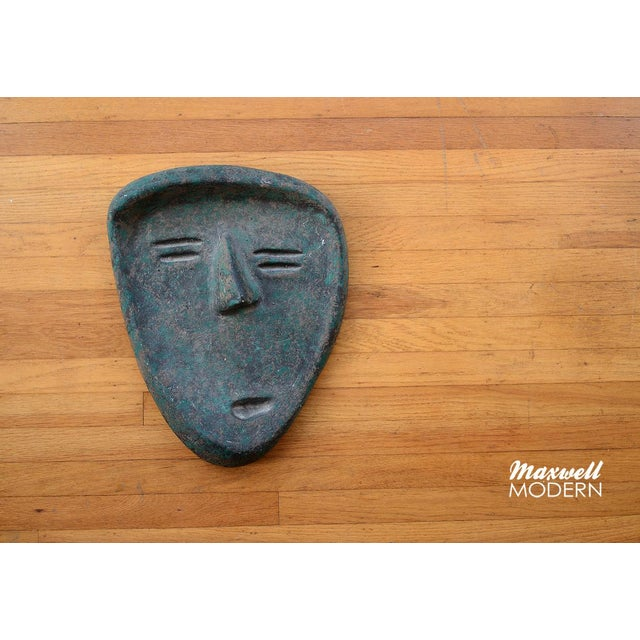 A very unique vintage ceramic face sculpture with a rustic textured dark green finish. Quite a charming looking face...