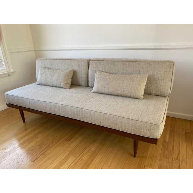 Mid-century sofa. Wooden frame with fabric cushions. Cushions are foam. The fabric is cotton and I'm guessing it has some...
