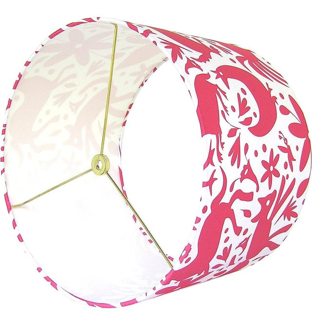 A drum lamp shade with an Otomi style pattern. Handmade item Materials: designer fabric, wire lamp shade rings, styrene...