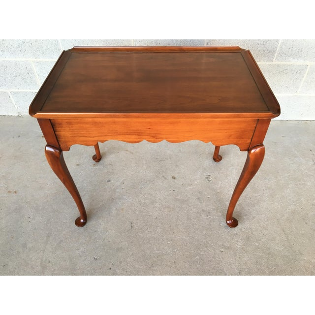 Statton Old Towne finish solid cherry tea table. Made in 1973. In very good vintage furniture condition. Normal age wear,...