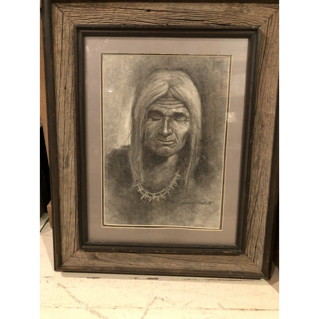 Original, signed charcoal drawing of a Navajo Man. Matted and enhanced within a wonderful rustic wooden frame. The actual...