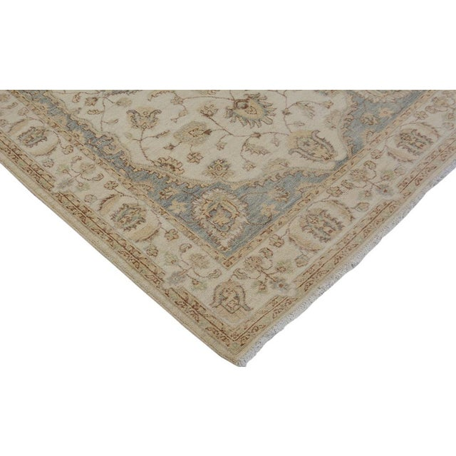 Embellish your home with this luxuriously hand knotted rug featuring an elaborate design made by creative artisans in a...