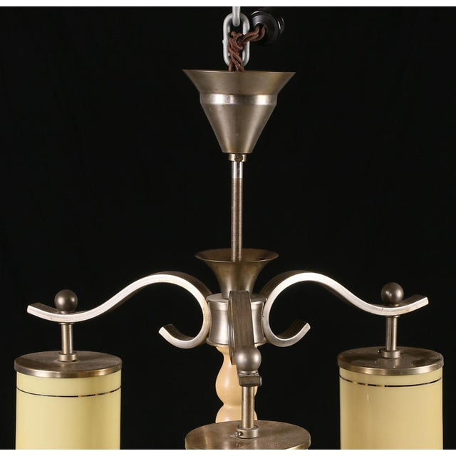 Art Deco chandelier with a nickel-plated brass frame, cylinder-shaped striped glass shades. Manufactured in Denmark in the...