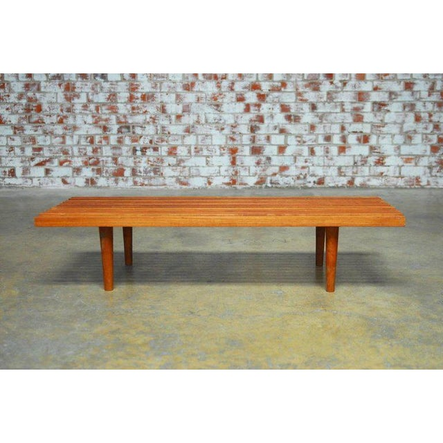Sleek Mid-Century Modern low slat wood bench coffee table featuring a delicate slat wood top. Simple Minimalist style...
