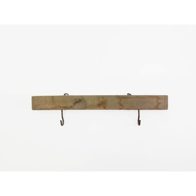 This is a vintage metal hook rack or sign holder. It features a simple wood back board with a beautiful green undertones...