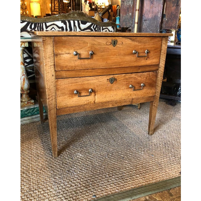 This is a charming late 18th c./early 19th c. Italian solid walnut chest of drawers in the Directoire style. The...