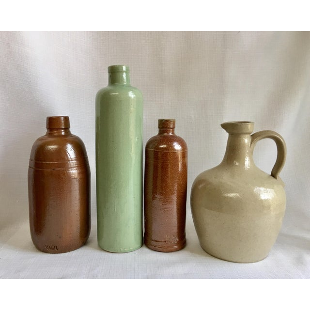 Set Of four rustic stoneware bottles & jug including a Jim Beam bottle & French wine bottle. Lovely rustic charm with...
