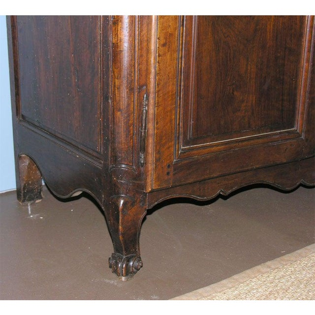 A French walnut buffet with one drawer, two panelled doors and one interior shelf, nicely carved escargot feet, original...