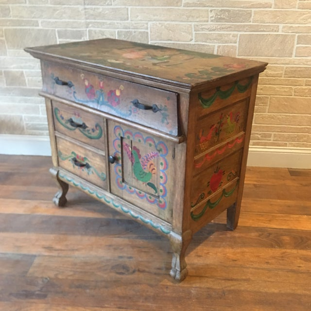 An extremely charming Early 21st Century Dutch Folk Art painted oak chest. Storybook style scenes depict a boy and girl...