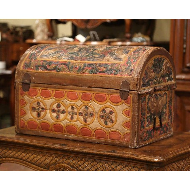 This beautifully executed antique wedding trunk was crafted in Germany, circa 1780. The decorative, arched box has iron...