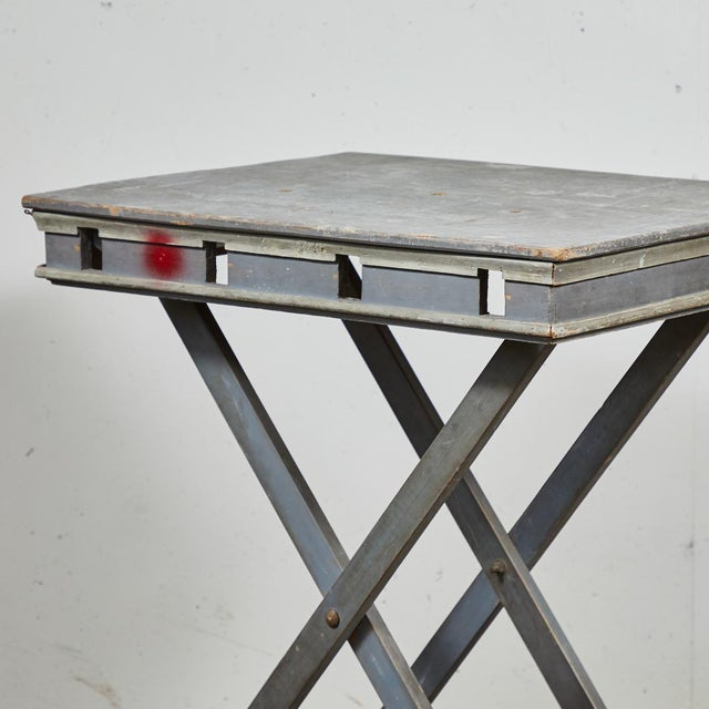 A French, 1840s presentation table on X-shaped foldable platform. Used for displaying models or sculptures. Also can be...