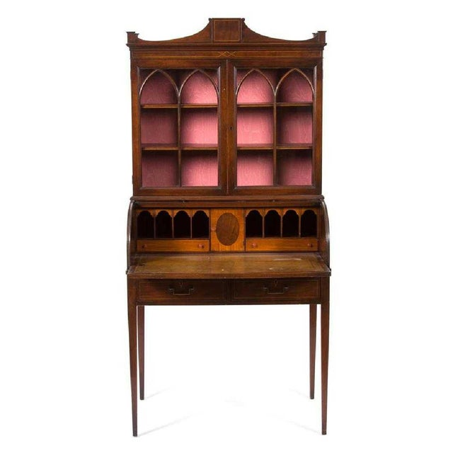 This is a superb quality American Empire Mahogany Tambour Secretary Desk 19th century having roll top opening to a...