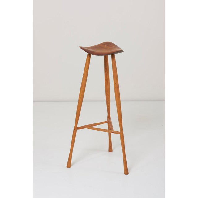 Well designed and executed American craft stool with fantastic form and patina designed by Karl Seemuller. Sculpted free-...