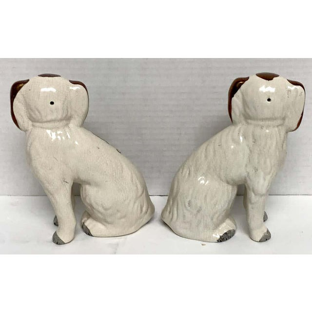 Pair of 19th century Staffordshire diminutive copper luster dogs, facing left and right with chains and padlocks, standing...