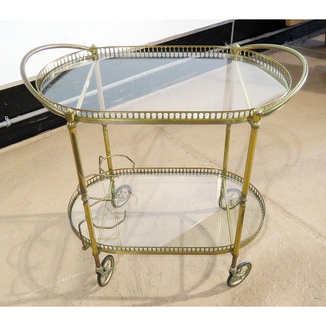 Italian 2 tier brass bar cart with glass inserts on wheels.