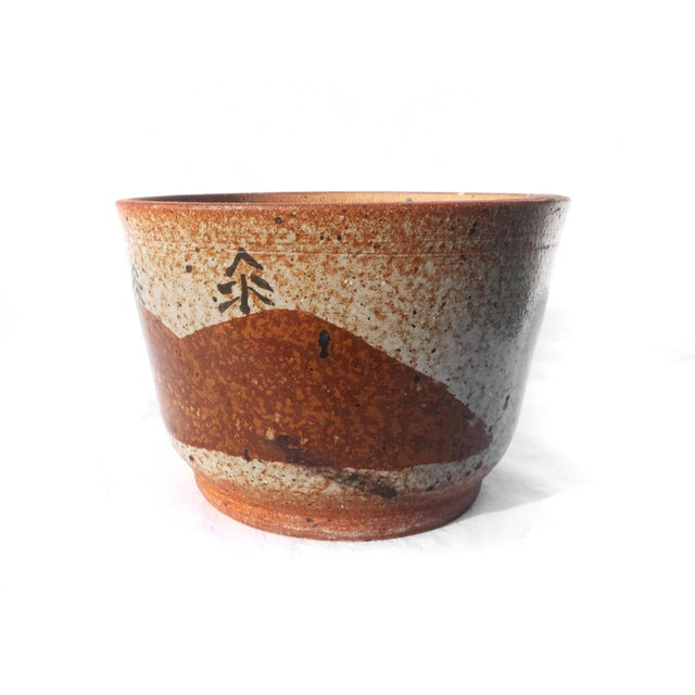 Beautiful handmade glazed earthenware planter in tan, brown, orange and black with landscape decoration. In excellent...