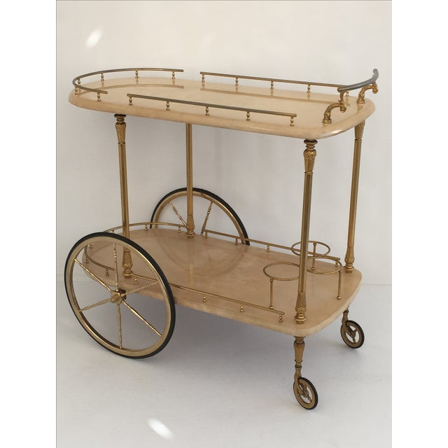Offered is an Aldo Tura cream lacquered parchment rolling bar cart/ drink trolley. This elegant piece is the perfect...